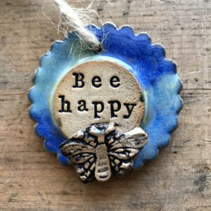 This handmade Bee Happy Pottery hanger is perfect gift which can act as a reminder to bee-happy.