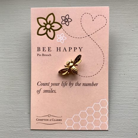 Bee Happy Pin Brooch on a pink card with the message bee happy